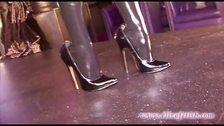 EB in latex stockings and heels with a pole.