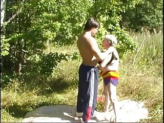 Mature ladies outdoors Mature lady with boy 05
