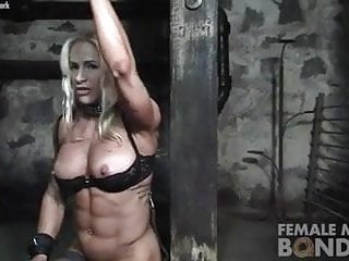 Naked female legs spread with chaines - Female bodybuilder in chains in the dungeon