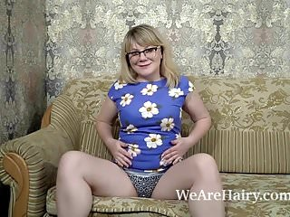 Natural strip - Evlalia strips naked and masturbates on her sofa