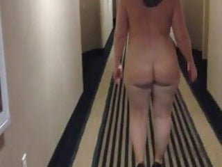 Walking naked in building Sexy milf in heels walking naked in motel hallway