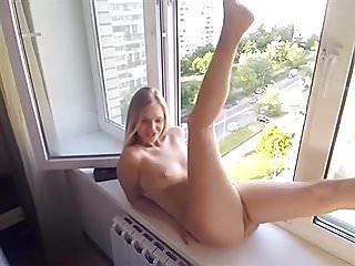 Electric sex gleaming in the window Girl dildo fucks herself in the window