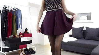 Modeling mini skirts, tops, tights and heels
