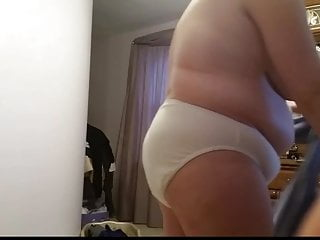 Girdle milf Bbw wife putting on her black girdle over her big tits