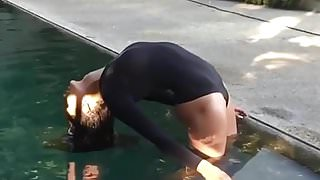 Nina Dobrev rising from the water in slomo.
