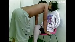 Indonesian Jilbab girl Playing on the chair and standing