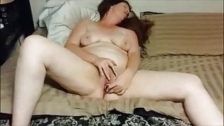 Wife fucking herself with a dildo