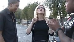a mature woman with 2 black men