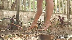 Perfect legs and feet kicking rubber ball with heels