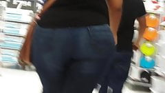 Candid Mexican milf hauling around a big ass.
