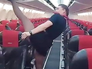 Sexy air stewardess pics - Sexy air hostess stretching legs in black tights pantyhose