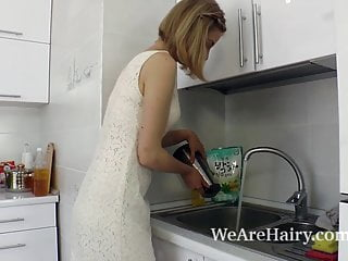 Naked contorsonist videos - Kristinka undresses in the kitchen and plays naked