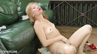 Keti strips to pleasure herself in different positions.