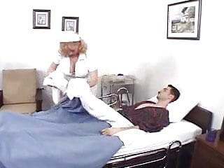 Nurse takes anal temperature A good nurse takes care of the patient