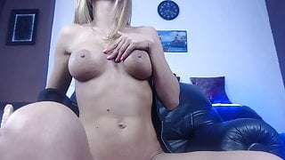 Busty blonde playing with her bald pussy with her dildo