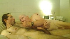 Elderly man squeezes young mans nipples