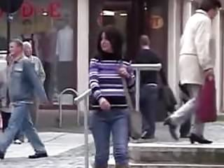 Filmed stripped naked while walking - Daring jeans peeing while walking on the street 1