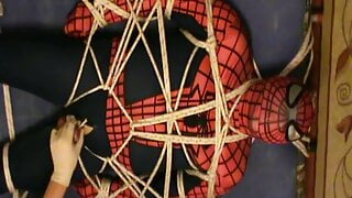 Restrained spiderman gets an enjoying