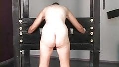 Cute brunette prisoner of war is stripped naked before torture interrogation