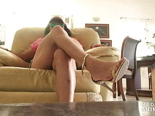 Traction covers for bottom of chair leg Candid muscle leg show in sexy shorts in reclining chair