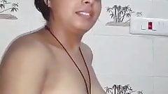 Indian cuteface girl show her boobs in bathroom