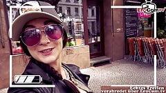 german instagram girl pick up a Fan on Street in supermarket