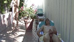 Brunette man sucks his lover in the garden and licks cum