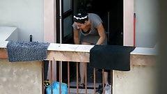 Neighbor shows downblouse on the balcony