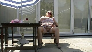 Big boobs mature outdoors in a white girdle & stockings