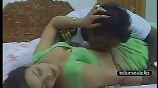 Reeva aunty in green saree with customs officer