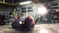 Biker girl hogtied in the garage