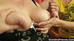 Two buddies share chubby old grandma with big tits