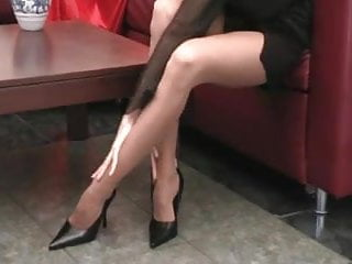 Long pantyhose tube Sexy babe with long legs tears open her pantyhose