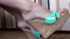 Long slender toes in green wedge shoe