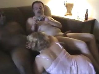 Hubby cock sucking - Hubby watches wife sucking black cock.