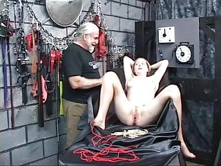Fetish dungeon tricks - Cute bound girl has clothespins clipped all over her cunt in bondage dungeon