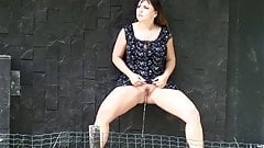 Sexy Brunette In Dress Takes Stand Up Piss