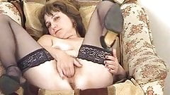 Russian milf fingering her pussy on the chair