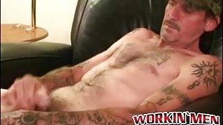 Tattooed mature amateur masturbates small cock and cums