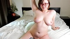 Brunette with glasses shows her holes