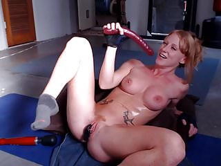Redheaded woman seeking a man Ginger girl with fit body plays with toys on webcam