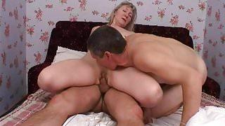 blonde stepmom on bed