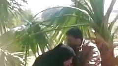 Hijabi girl please her man discreetly in public