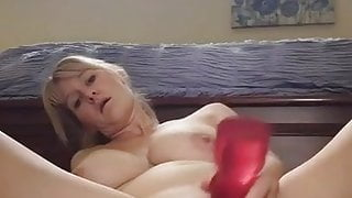 Wife fingers her ass while riding her big toy
