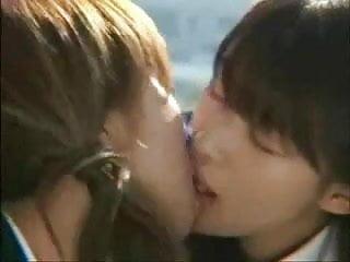 Two teen girls kissing - Two beautiful asian girls - kiss