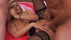 Mature blonde with pierced cunt takes 2 men