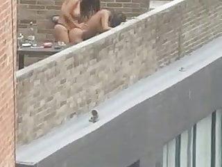 Lesbian strapon doggy fuck Mistress fucks her whore on rooftop balcony