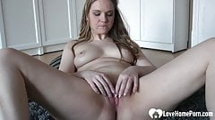 Cute brunette plays with her wet snatch