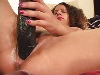 Amateur in bed Amateur brunette uses huge dildo before taking black cock in bed