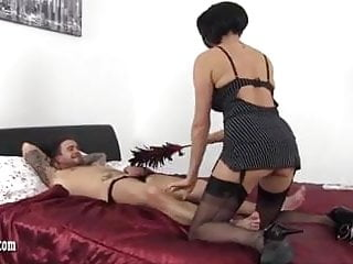 Sexy brunette wanking - Sexy milf gives foot wank and handjob to big throbbing cock